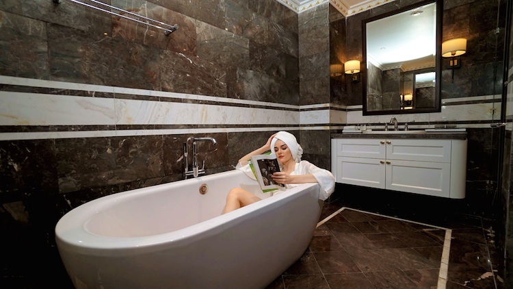 Reading a magazine while warm water massaging your skin is a memorable moment at FLC Grand hotel.