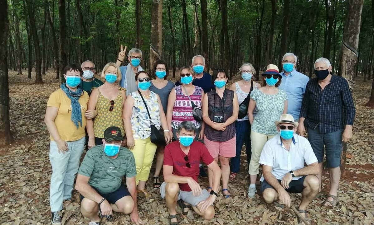 A group of French tourists visit a rubber forest on their way from Dak Lak Province to HCMC on March 17, 2020 after being denied entry by authorities in Kon Tum Province. Photo acquired by VnExpress.