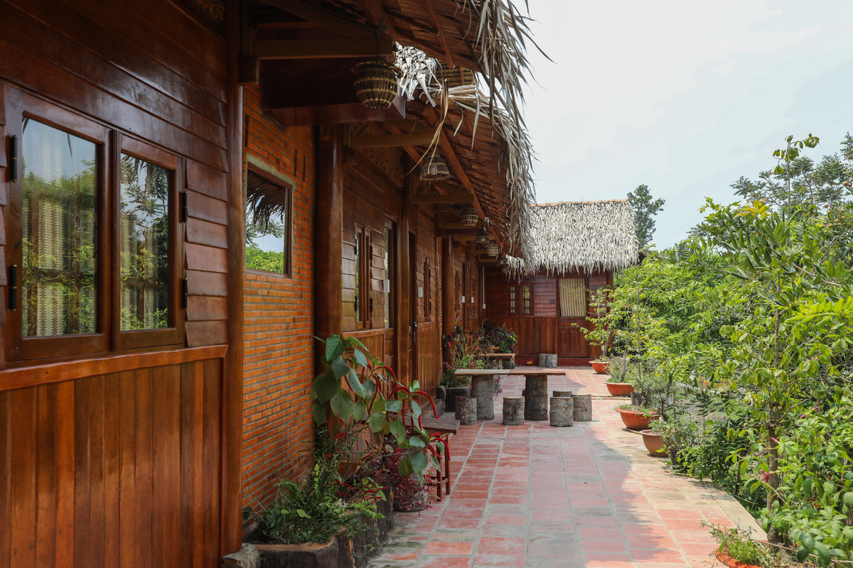 With six coconut-themed thatched bungalows, Giac's homestay can accommodate 30 people at a time. The bungalows face a fruit garden.