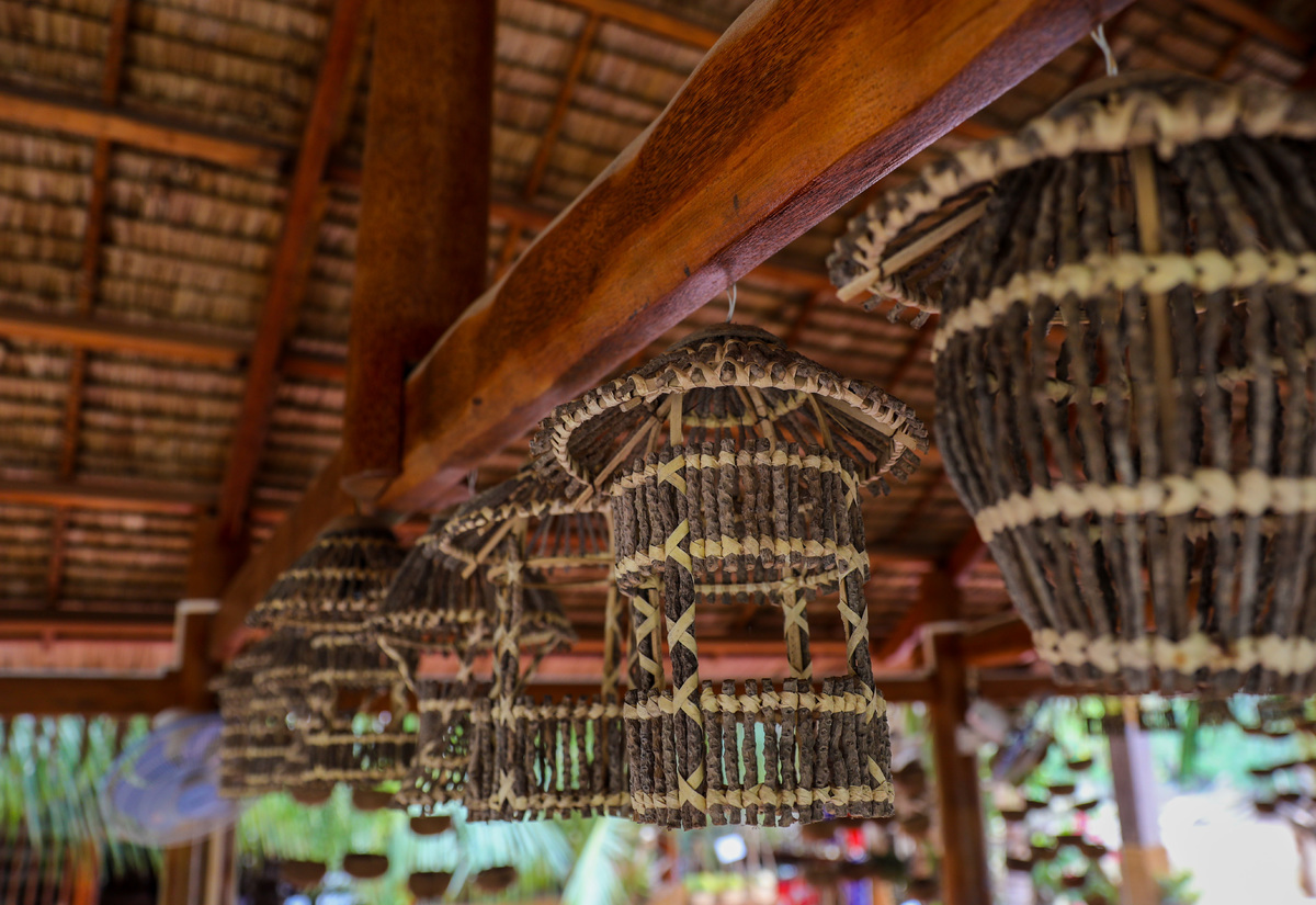 Lamps hanging over the homestay were handcrafted from dried coconut flowers.