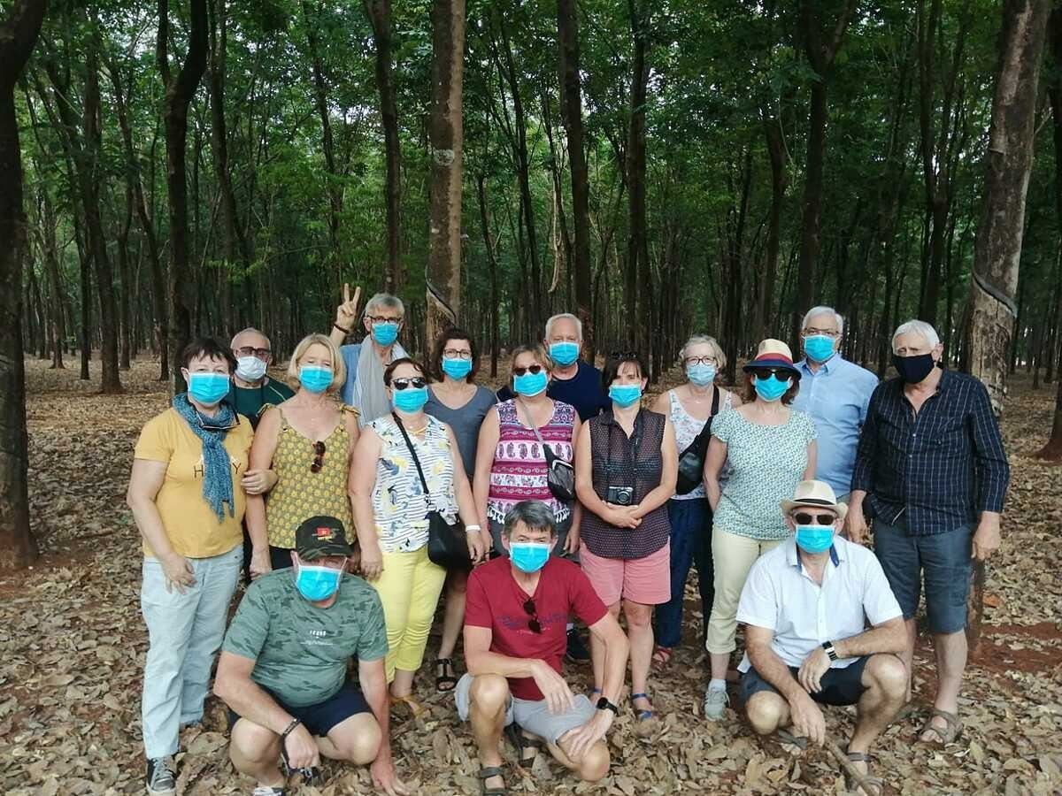 A group of European visitors visit a rubber forest during their trips to the Central Highlands. Photo by VnExpress/ Nguyen Nam.