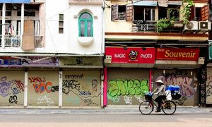 Lockdown of 'non-essential' shops empties Hanoi streets