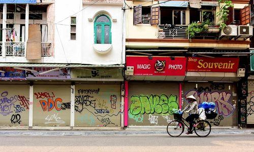 Lockdown of 'non-essential' shops empties Hanoi streets