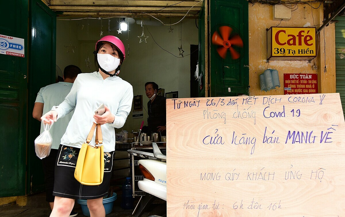 A coffee shop on Ta Hien Street has a 'Takeaway only' sign.