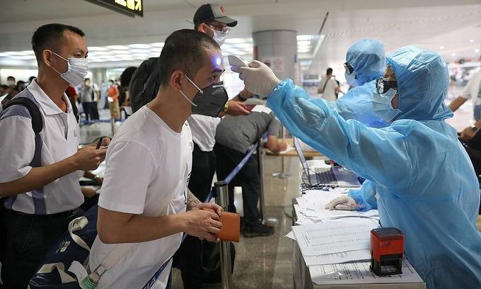Don't come home now, Vietnam advises citizens abroad