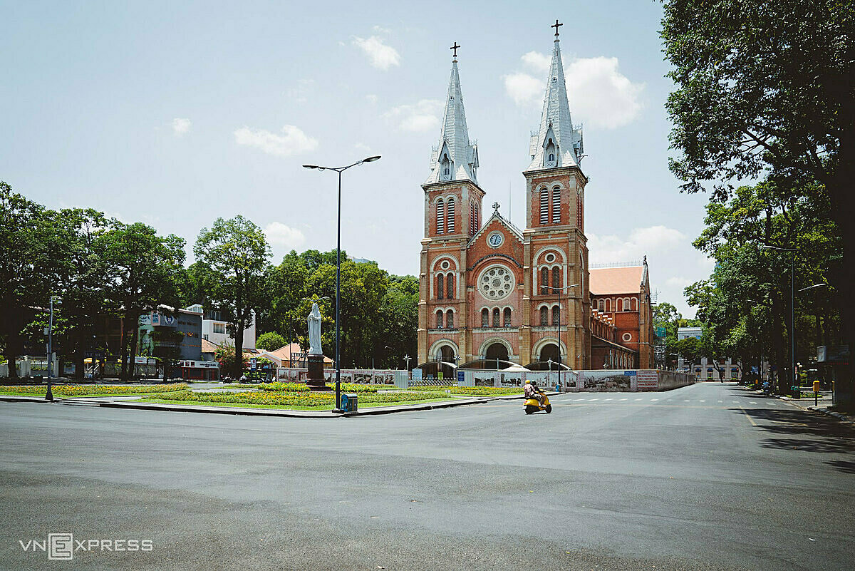 Sparse traffic in the area around Saigon Notre Dame Cathedral, District 1, was built by French colonialists between 1863 and 1880. It has two bell towers that stand at a height of 58 meters (190 feet).