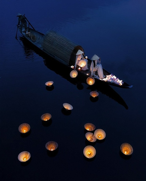 During the full moon festival, a long-standing celebration in Vietnam, people pray to the gods of water and for those who passed away. They drop lit candles in the river to pray for their souls, said Nong Thanh Toan who shot this photo on the iconic Perfume River in Hue.