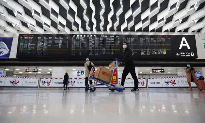 In coronavirus-hit Japan, Vietnamese dream of flying home