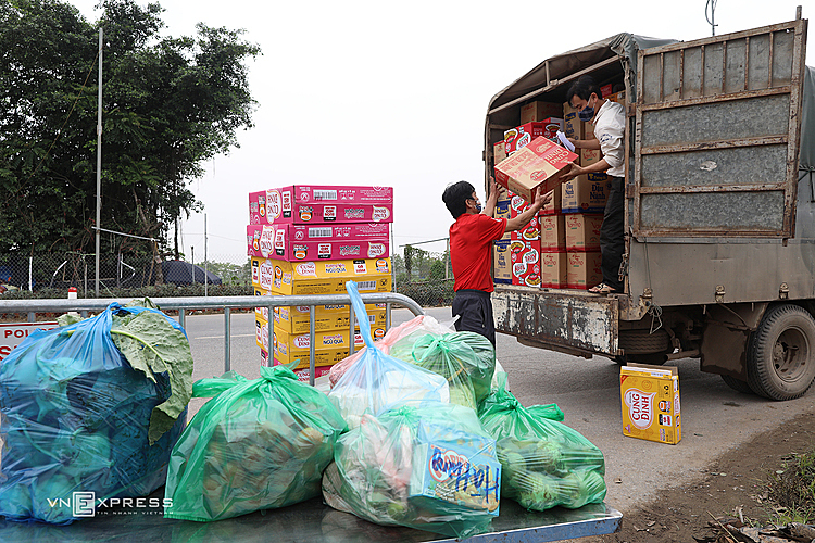 Trucks that carry necessities stopped at gate 5 on 23B highway, where they are loaded off and transferred into the village.