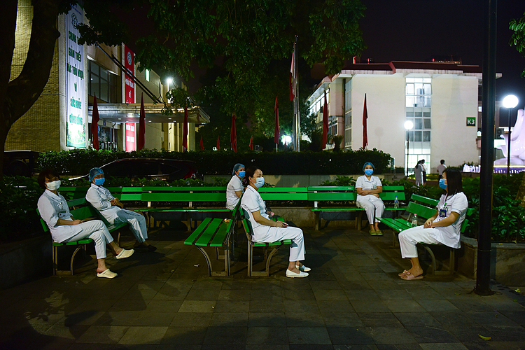Doctors sat outside and far away from each other to wait until midnight.    I'm getting emotional because after 14 days, I will get to go home and see my family and my kids again, said Dao Thi Ngoc Nha, a nurse at Nuclear Medicine Oncology Center, Bach Mai Hospital.