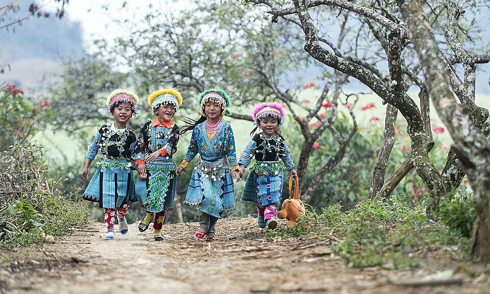 Shot of local children wearing traditional clothes in the Lunar New Year Break in northern Moc Chau Province is also in the top 50 finalists. Photo by Agora/nguyenvuphuoc.