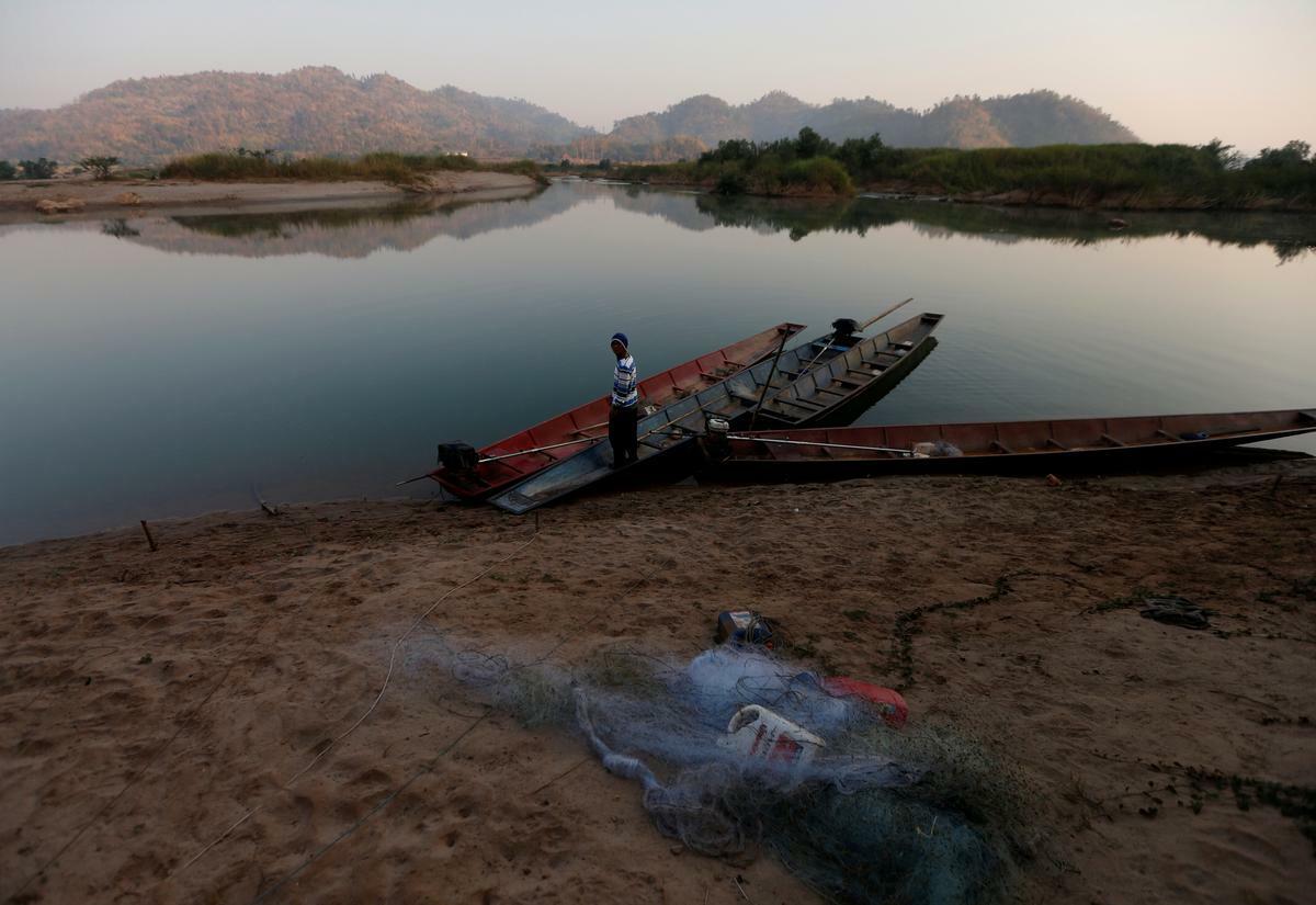 A fisherman is seen on the Mekong River bank outside Nong Khai, Thailand January 10, 2020. Photo by Reuters/Soe Zeya Tun