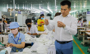 Mask exports offer pandemic-hit Vietnam garment makers breathing space