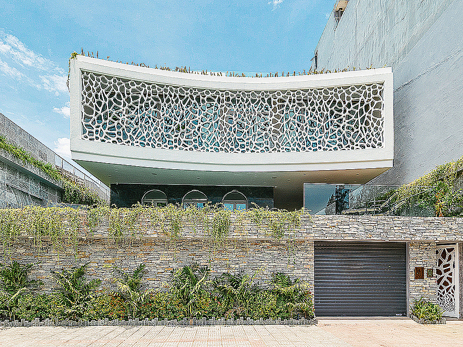 Located in the central city of Da Nang, the villa is directly affected hot and humid climate. Homeowners takes inspiration from local corals to ddesign a facede preventing sunlight and giving them more privacy.