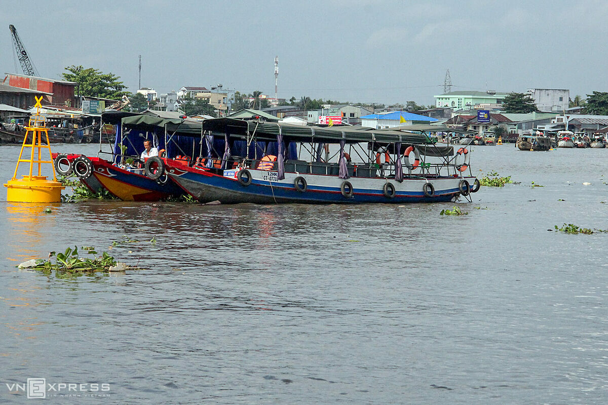Without visitors, tourist boats anchored day after day in front of Cai Rang Floating Market, which floats on Hau River, a branch of Mekong River in Vietnam. Before the Covid-19 outbreak, every day about 200 boats takes visitors to the Mekong Deltas largest floating market.The wholesale market, a major tourist attraction in Can Tho, is the biggest of its kind in the Mekong Delta where trading on waterways has been a way of life for generations. The 40-minute boat ride is the best way to explore life along the waterways as it passes houses built on stilts over the water and boats in a bewildering variety of sizes, shapes and colors docked along the shore.