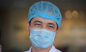 Vietnam doctors drink less water, wear diapers in Covid-19 fight