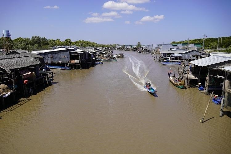 Stilt houses line both sides of Vam Mui River.