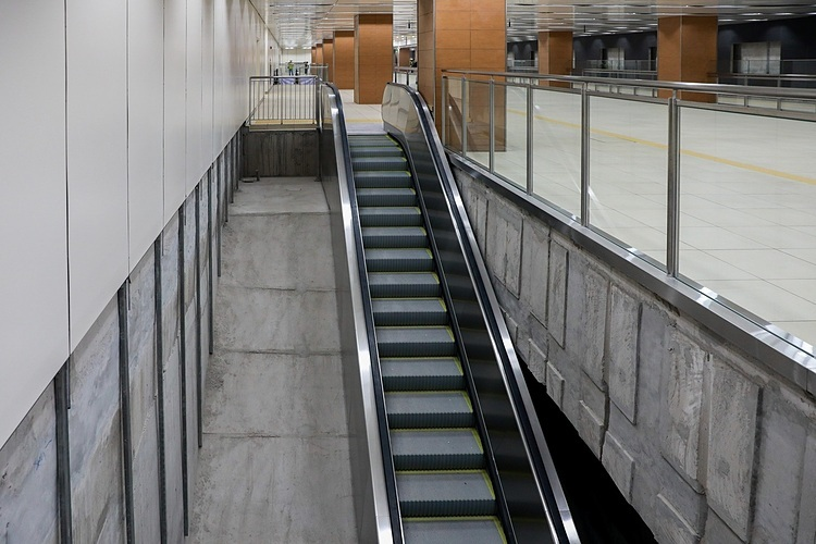 There are two escalators, two stairs and an elevator leading down to the next floors. By design, the four floors of the underground station are 36 meters underground. The second and fourth underground floor are where the trains stop to pick up and drop off passengers. The third floor is the area for staff, electrical equipment, ventilation, sewage pumping system and disaster control center.
