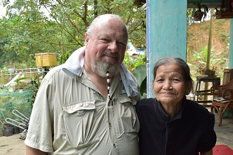Grant Coates standing next to a mother of an agent orange victim in central City of Da Nang in 2018. Photo courtesy of Coates.