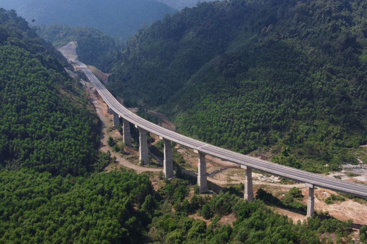 An overpass hovers above a valley at the Bach Ma National Park. The expressway has 36 overpasses in total.