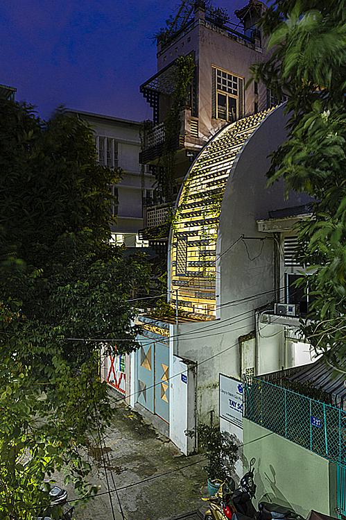 The facade creates a unique light effect at night.