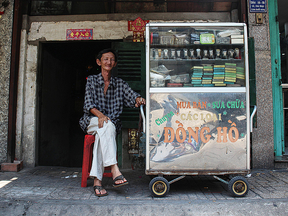 Giang Ty, 65, is a Sino-Vietnamese living in Ho Chi Minh City. With 40 years of experience, he is one of the most senior horologist in town. Not remembering how he started fixing these timepieces, Ty operates his shop with this cart in Saigon's District 6.
