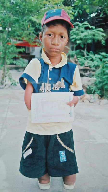 The boy has one set of clothes to go to school. Photo courtesy ofNay Djrueng.