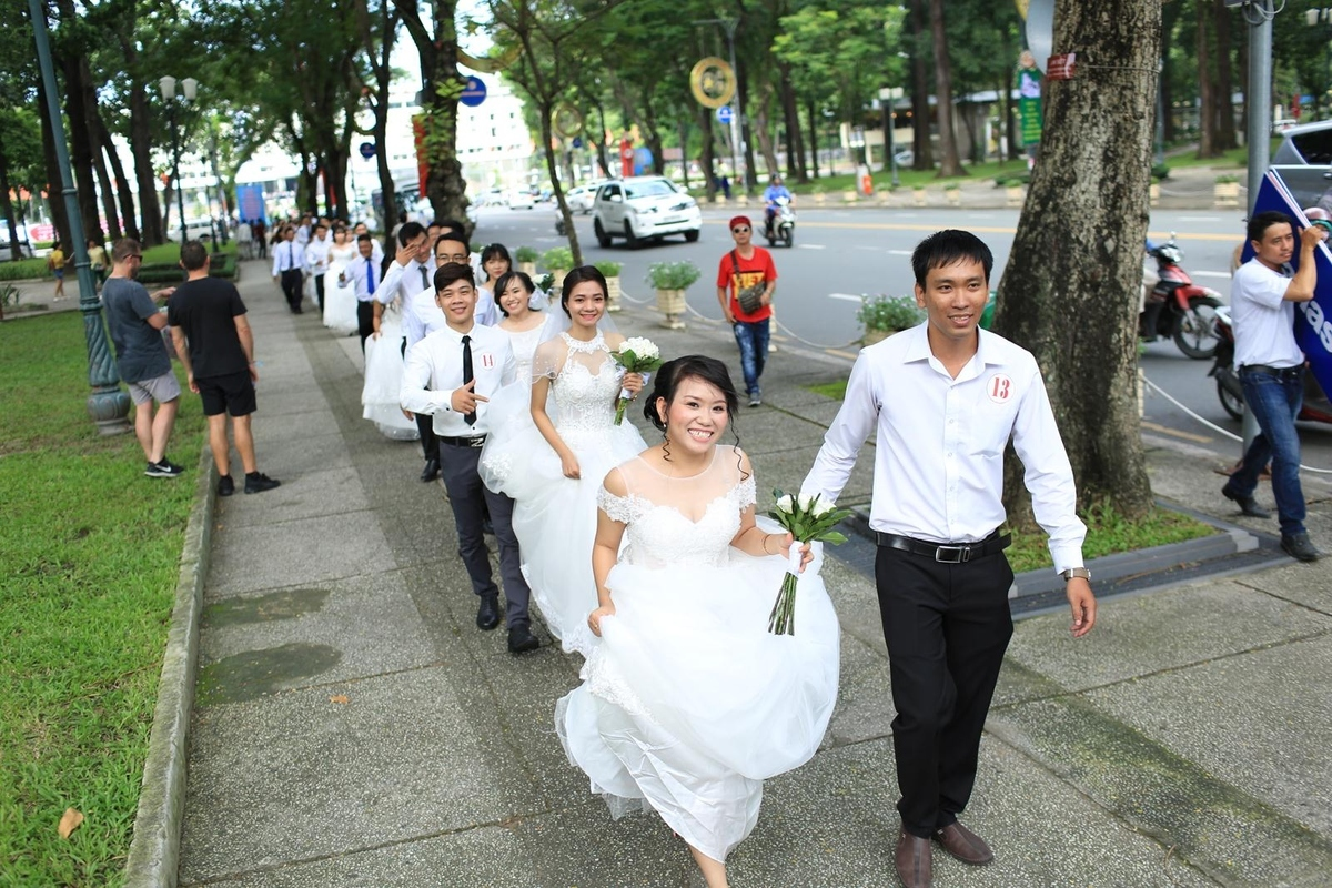Couples attend their mass wedding in Ho Chi Minh City. Photo by VnExpress/Viet Anh.