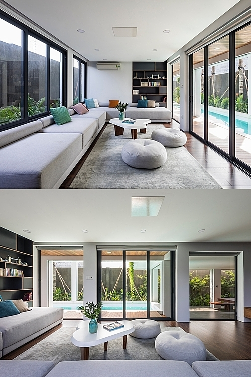 The living room is located between a swimming pool and a small garden, offering a full view of the outside.
