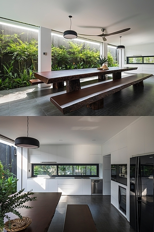 The kitchen and dinning area are interconnected with the greenery outside. A system with two layers of roll up doors (one is made of stainless steel, the other is made of aluminum) protects the inside from bad weather and security issues.