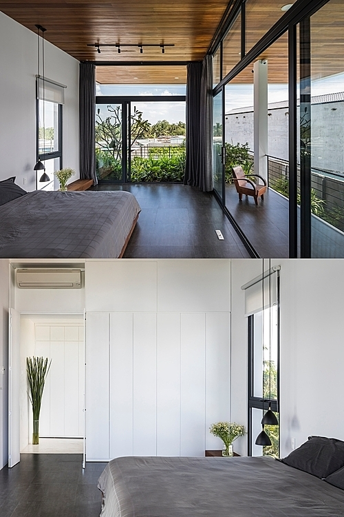 Minimalist parents bedroom with a big window, giving a great view of the greenery.