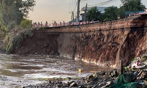 Highway stretch collapses into Mekong river four days after cracking