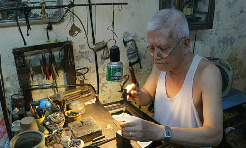71-year-old jeweler hammers out a living in Hanoi's Old Quarter