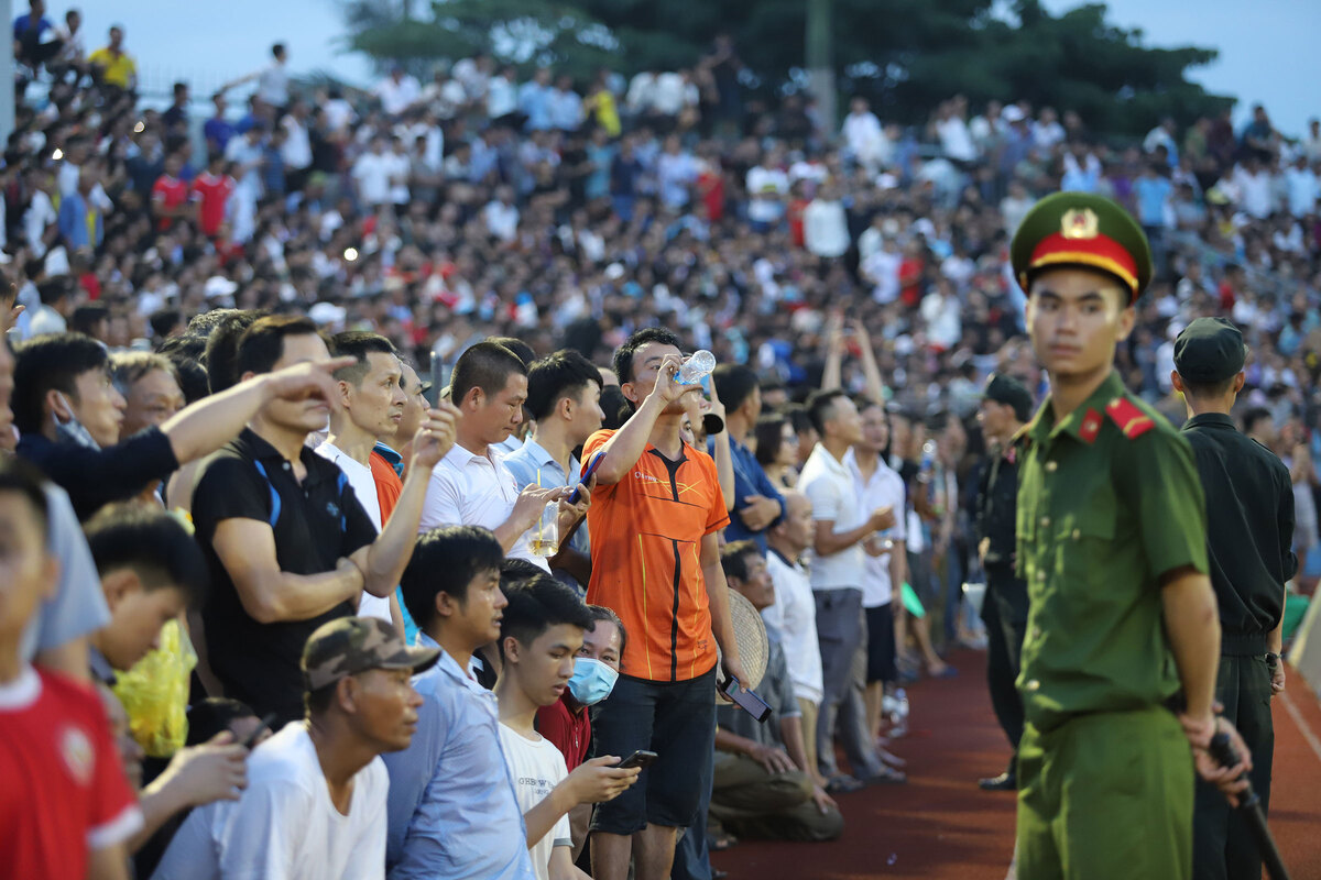 Vietnam football fans throw caution to the wind, disrupt game