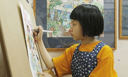 When mere words won't do: Hanoi girl's drawings chronicle pandemic