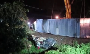 Three killed as container truck flips over car in northern Vietnam