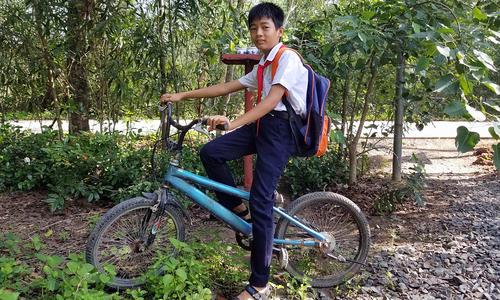 Boy reaps reward for selfless flood prevention drive