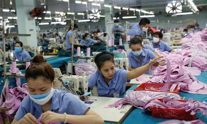 Labourers work at a garment company in Ho Chi Minh City. Photo by Reuters/Yen Duong.