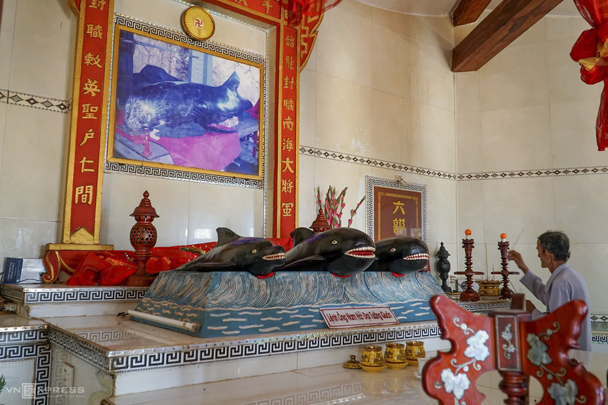 Inside the temple, villagers lay photos, statues and bones of whales. Fishermen come here to pray for peace and luck every time they are about to set sail.