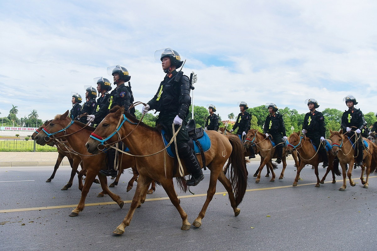 The horses parade along with their riders.