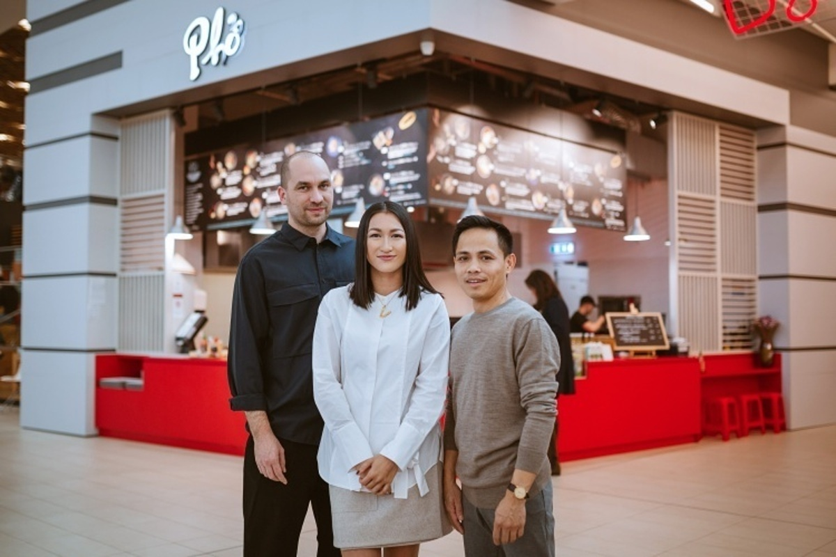 Huongs husband Jozef (left) stand with her and her cousin Thang Tran in front of one of the restaurant branches in Slovakia. Photo courtesy of Lucia Thao Huong Simekova
