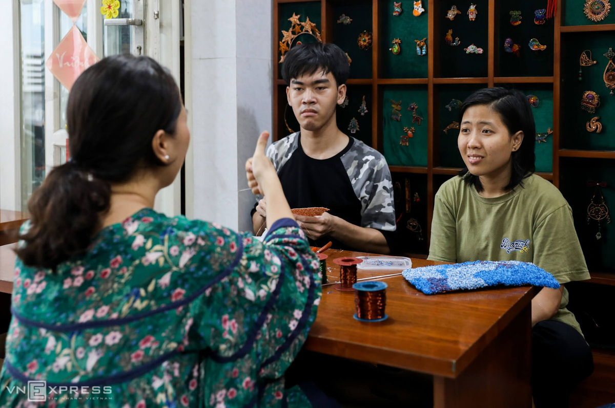 Phuong uses sign languages to communicates with her students.