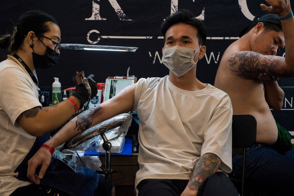 A man gets inked at a studio in Saigon. Photo by Shuttlestock/All themes.