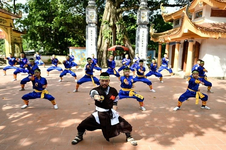 Master Nguyen Khac Phan (front) leads students through a training class in centuries-old martial art Thien Mon Dao inside the Bach Linh temple compound at Du Xa Thuong village in Hanoi.