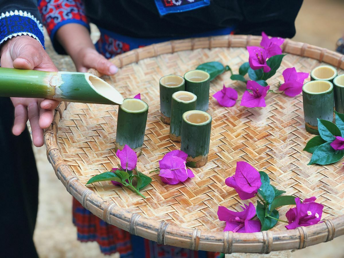 Cardamom drink in bamboo tubes.
