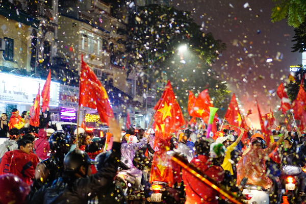 Confetti rain down Hue Street in downtown Hanoi. Photo by VnExpress/Dung Luong