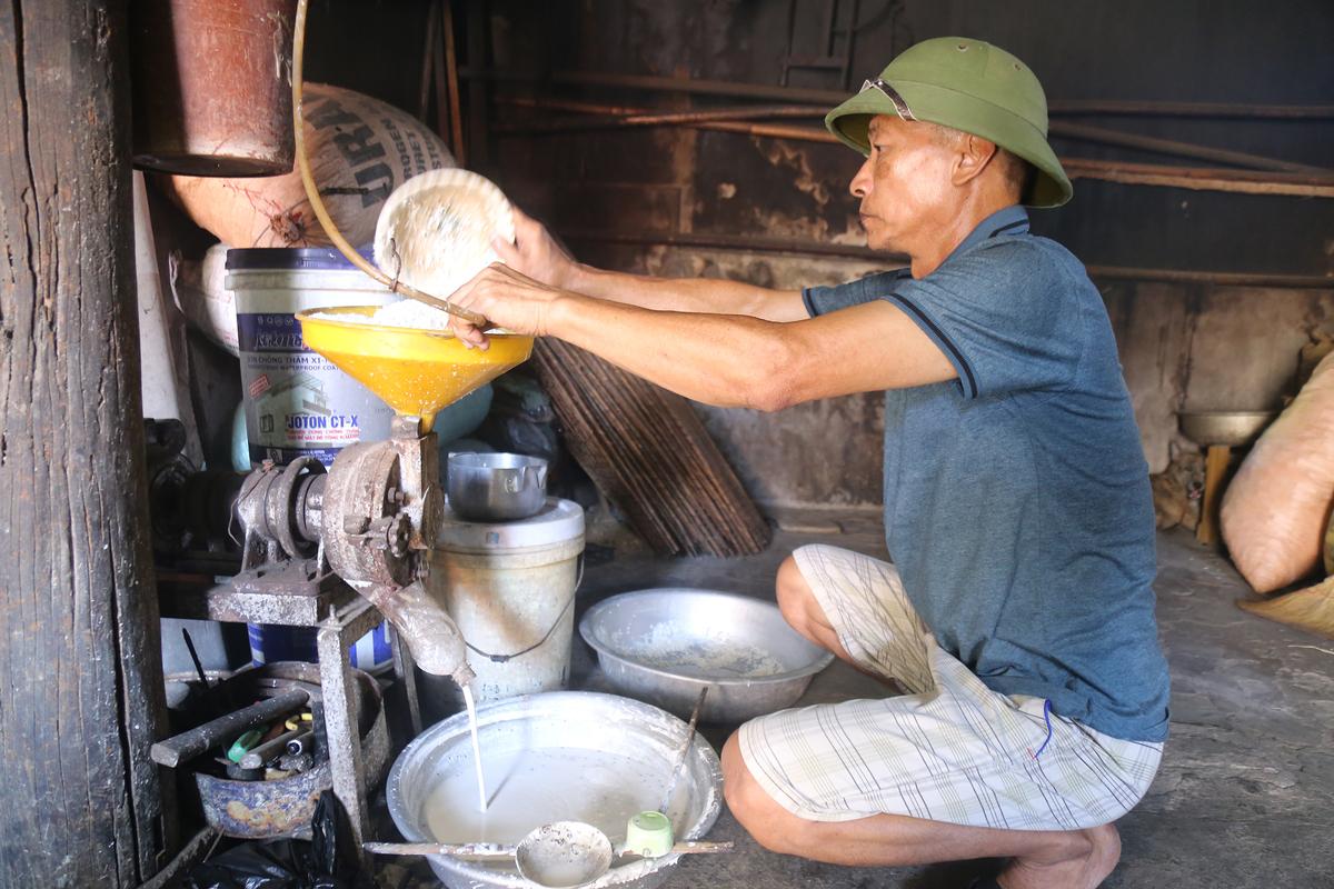 Rice paper making under scorching central Vietnam sun