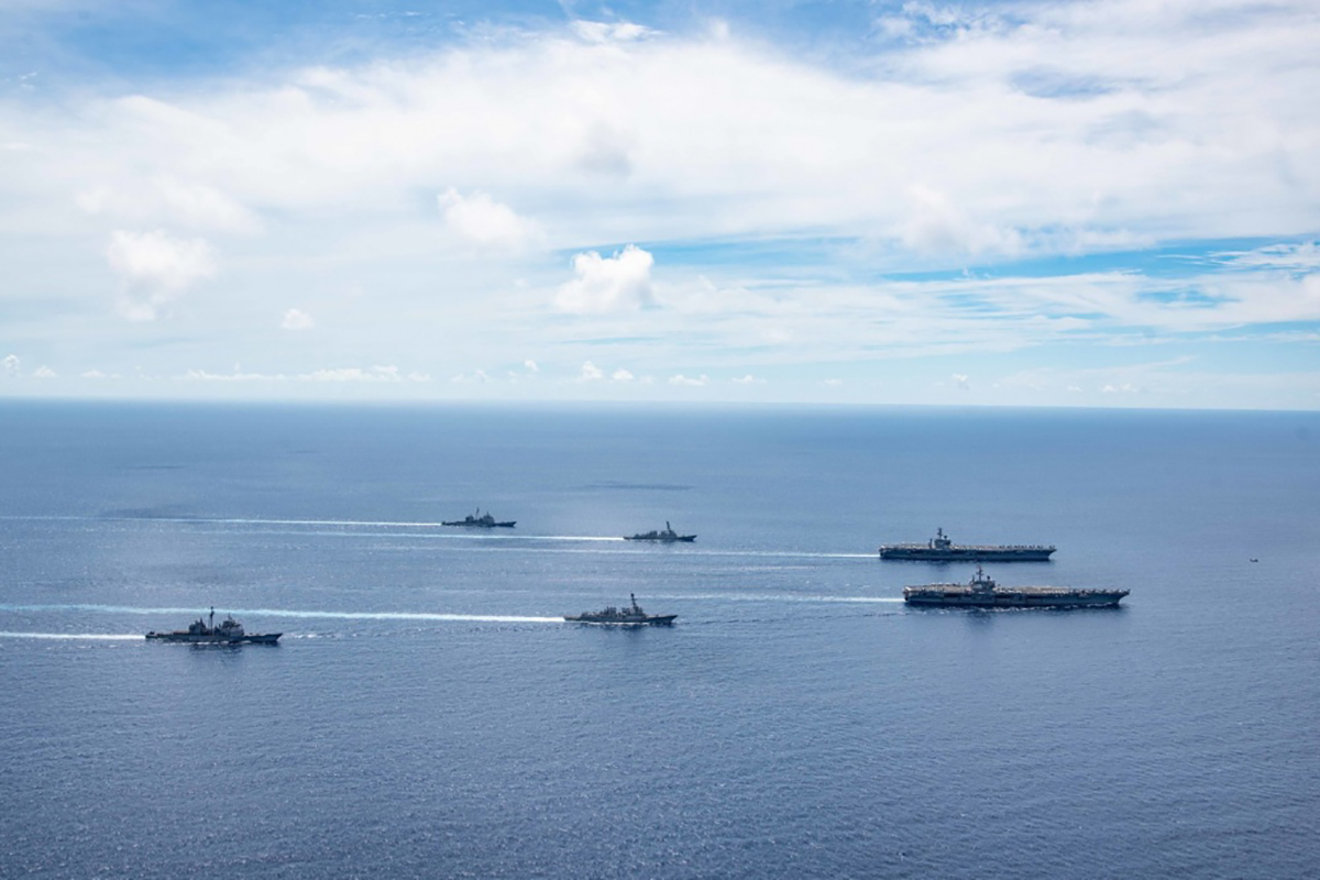 The USS Ronald Reagan, the USS Nimitz and other accompanying vessel perform drills on the South China Sea, July 6, 2020. Photo courtesy of the U.S. Navy.