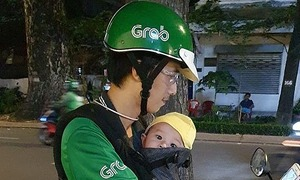 Motorbike taxi driver takes infant son along for every ride