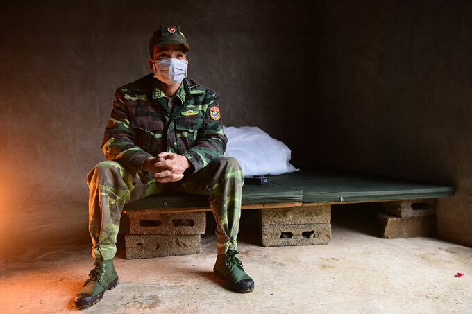 A Vietnamese soldier sits on his bed at a station near the China border in Lang Son Province, February 2020. Photo by VnExpress/Giang Huy.